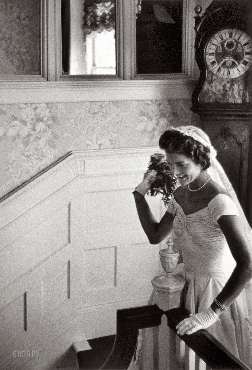 "Sept. 12, 1953. Newport, Rhode Island. ""Kennedy wedding -- Jacqueline Kennedy throwing the bouquet."" Gelatin Silver print by Toni Frissell."