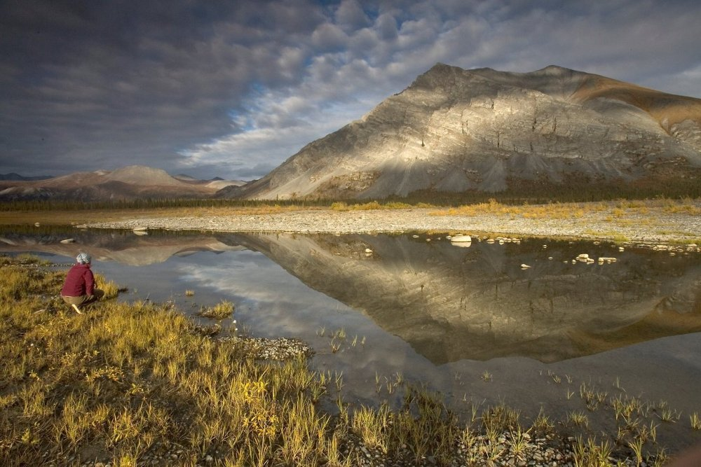 Happy Birthday, Arctic National Wildlife Refuge! The iconic refuge, home to polar bears, moose and caribou, was established Dec. 6, 1960. In 1980 the federal government expanded it to its current 19.6 million acres, almost half of which are wilderness. Photo: Last Lake on Sheenjek River, Arctic Refuge, by Steve Hillebrand/USFWS, tweeted by the US Department of the Interior, 12/6/13.