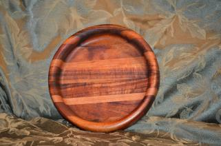 I made two of these small, shallow bowls. Woods are Koa (in the middle), Cherry (next to the Koa) and Tigerwood. Rather spectacular, and the Koa changes colors as you rotate it in the light.