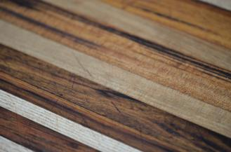 Even with the sanding of the boards, some cuts remain. That's OK: remember, the essence of a cutting board is to be cut upon. Every cut, every scratch reminds me of a wonderful meal prepared in this kitchen.