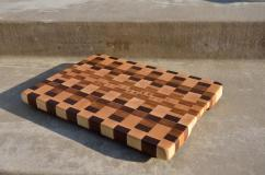 # 59 Cutting Board, $85. Hard Maple, Walnut, Canary Wood and Cherry.