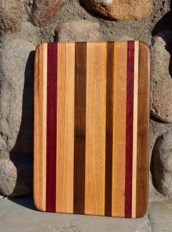 # 6 Cheese Board, $30. Red Oak, Hard Maple, Purpleheart, Cherry, Walnut, Yellowheart