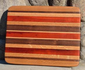 # 3 Cheese Board, $30. Cherry, Walnut, Red Oak, Padauk, Hard Maple