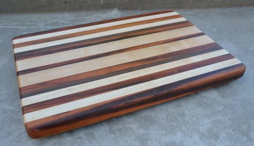 # 76 Cutting Board, $175. Edge Grain. The brown/black wood is Goncalo Alves, AKA Tigerwood. Also, Hard Maple, Walnut.