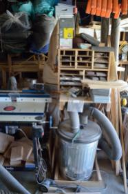 The dust collector is tucked behind the sand paper, which is on a stand sitting above the cyclone separator. That's the router table to the left. How could I have a dust problem if I can't even SEE the dust collector?