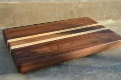 "# 72 Cutting Board, $100. Black Walnut and Hard Maple, edge grain. 16-1/4"" x 11-5/8"" x 1-5/8""."