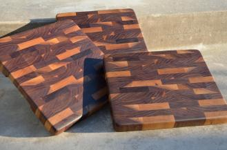 "Three pieces were made from some walnut I got from a contractor doing home restorations. There are 3 slightly different sizes. # 1 is 11-3/8"" x 10-3/4"" x 1-1/8"". # 2 is 10-5/8"" x 10-1/2"" x 1-1/8"". # 3 is 10-7/8"" x 9-1/4"" x 1-1/8"". End Grain. Black Walnut."