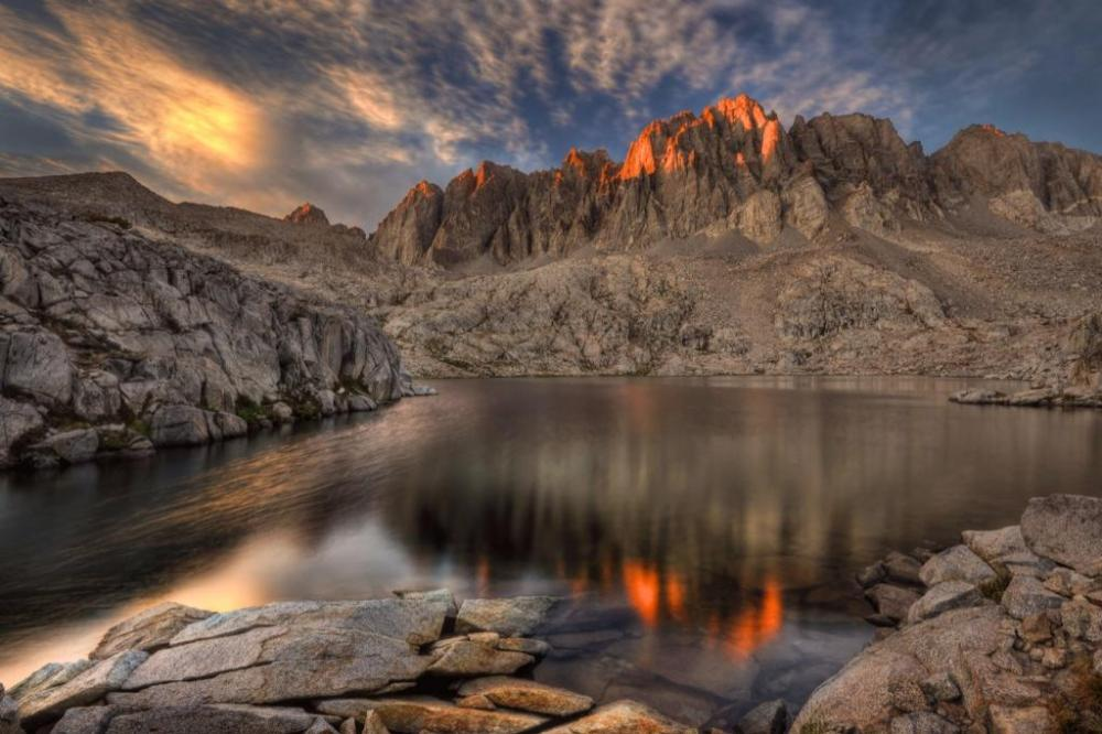 "This beautiful shot is taken ""somewhere"" in the Sequoia or Kings Canyon National Parks - which are jointly managed and referred to as SEKI in National Park code. The US Department of the Interior tweeted this lovely image on Monday ... but didn't identify where it is specifically, or (as is pretty normal for them) who the photographer is. I'm guessing this is a lake that's away up high in Sequoia National Park, above the tree line. Do you recognize this area?"