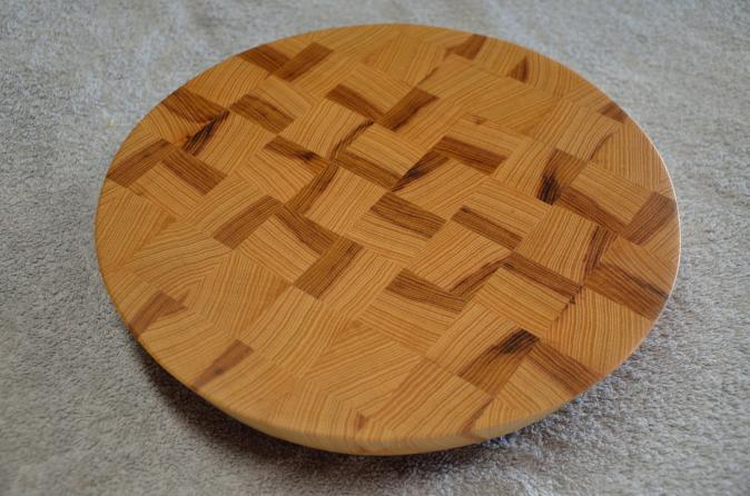 "Hickory end grain board. 14"" diameter x 1-1/4"" thick. 20 degree cant on the edge."