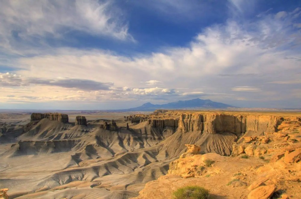 Skyline Rim near Factory Butte provides incredible, expansive views of the deserts of eastern Utah. The Henry Mountains offer a stout backdrop. Photo: Brandon Jolley. Posted on Tumblr by the US Department of the Interior, 9/15/14.