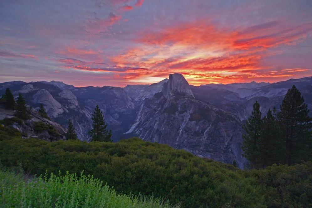 Sunrise over Yosemite's Half Dome. Tweeted by the US Department of the Interior on the Park's 124th birthday, 10/1/14.