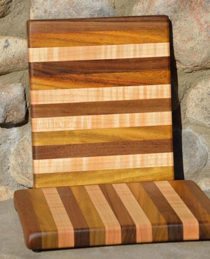 "Velda's favorite. Black Walnut, Teak and Curly Maple edge grain. 11"" x 9"" x 1""."