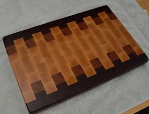 "# 64 Cutting Board, $125. Black Walnut, Cherry and Hard Maple. 19-1/4"" x 12-1/2"" x 1-1/2"". End grain."