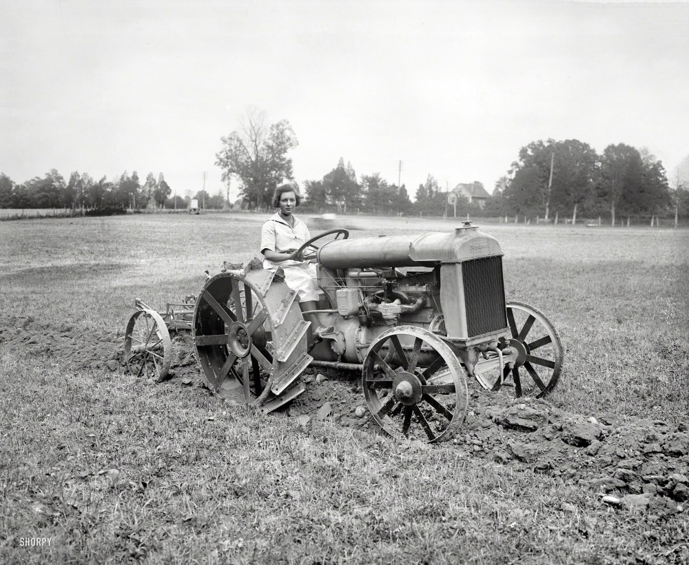 """Sept. 26, 1921. Fordson was a brand of tractors developed by Henry Ford using the same technology as the Model T. A photo in the Washington Star identifies this young lady as """"Miss Myrtle Lewton of Takoma, Md., Golden Eagle Girl Scout who received her decoration from the Queen of Belgium."""" National Photo Company glass negative, from Shorpy Historical Photos."""