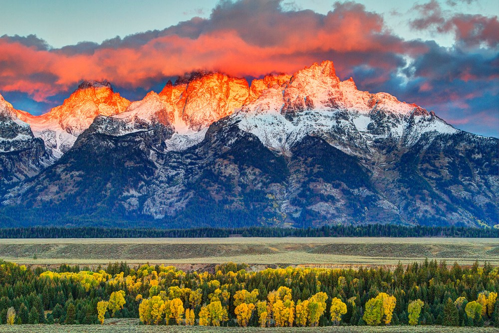 The Teton Range glow orange after a fresh coat of snow. Robert Buman captured this gorgeous photo just before sunrise at Grand Teton National Park in Wyoming. Posted on Tumblr by the US Department of the Interior, 10/21/14.
