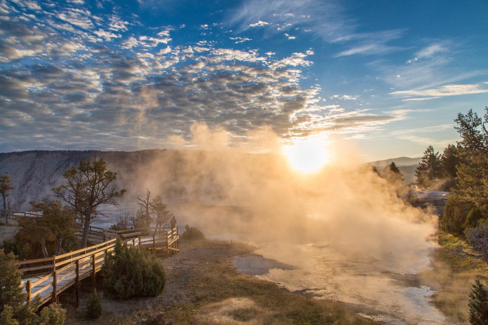 A gorgeous sunrise over Yellowstone National Park's Mammoth Hot Springs. Photo by Neal Herbert, National Park Service. Posted on Tumblr by the US Department of the Interior, 10/26/14.