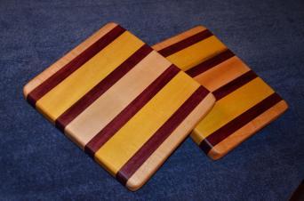 "# 16 Cheese Board, $35. Edge grain. Maple, purpleheart and yellowheart. 11"" x 9"" x 1""."