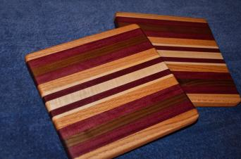 "Edge grain. Maple, purpleheart, walnut aand oak. 12"" x 12"" x 1""."