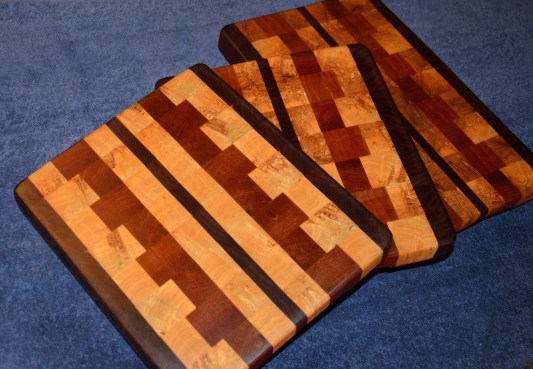 "End grain. Walnut, ash and cherry. Three sizes, 8"" - 12"" x 10"" x 1-1/4""."