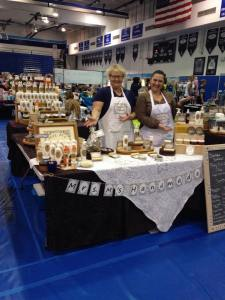 Here's the Mrs. M's at our first double booth at the big craft fair at Saugus High, where all 3 kids graduated. Quite a different look from their first booth, yes?