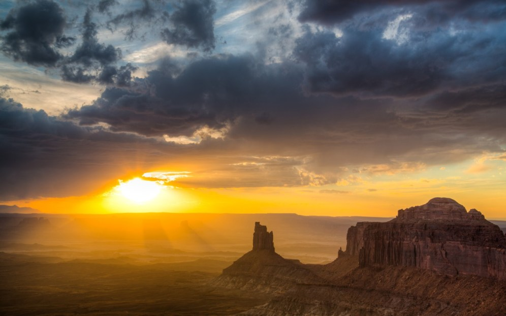 Sunset from Island in the Sky at Canyonlands National Park in Utah. One of four distinct districts in the park, the Island in the Sky mesa rests on sheer sandstone cliffs over 1,000 feet above the surrounding terrain. Every overlook offers a different perspective on Canyonlands' spectacular landscape. Photo by Jeremy Stevens. Posted on Tumblr by the US Department of the Interior, 11/30/14.