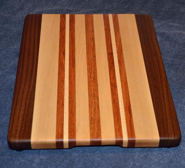 "Edge grain cutting board. Black Walnut, Hard Maple and Jatoba. 12"" x 16"" x 1-1/8""."