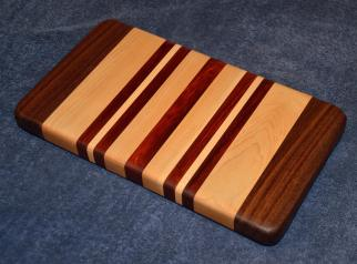 "Edge grain small board. Black Walnut, Hard Maple and Jarrah. 7"" x 12"" x 1-1/8""."