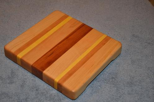 "Cheese Board # 15 - 012. Hard Maple, Cherry and Yellowheart. 8"" x 7"" x 1-1/4""."
