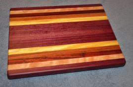"Cutting Board # 15 - 011. OK, settle down out there. Yes, this board is purple. You are welcome. Purpleheart, Curly Cherry, Jatoba, Padauk and Yellowheart. 12"" x 16"" x 1-1/4""."
