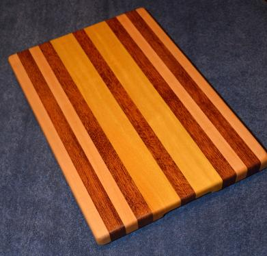 "Hard Maple, Jatoba and Yellowheart edge grain cutting board. 12"" x 16"" x 1-1/4""."
