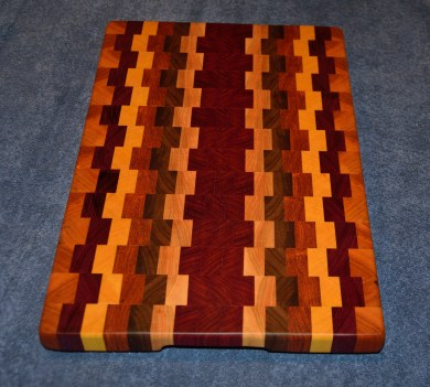 "Cutting Board 15 - 018. Cherry, Jatoba, Yellowheart, Walnut and Jarrah end grain cutting board. 12"" x 19"" x 1-1/4""."