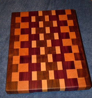 "Jatoba, Cherry, Hard Maple and Purpleheart end grain cutting board. 12"" x 18"" x 1-1/2""."
