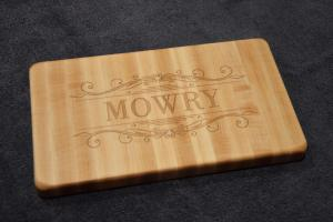 Engraved # 15 - 01. Hard Maple with engraving on one side; the opposite side is plain and intended to use as a small cutting board. 7