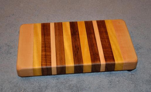 "Small Board # 15 - 022. Hard Maple, Yellowheart and Teak. 7"" x 12"" x 1-1/2""."