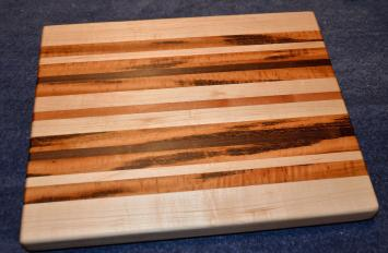 "Cutting Board # 15 - 023. Hard Maple, Cherry and Goncalo Alves, AKA Tigerwood. 12"" x 16"" x 1-1/2""."