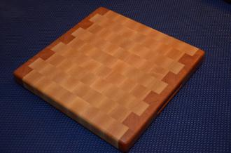 """Cutting Board 15 - 042. Cherry and Hard Maple end grain. 12"""" x 12"""" x 1-3/8"""". Side routed handles; no feet so it's a 2-sided board. Commissioned piece."""