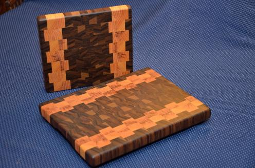 "Small Board # 15 - 034. Some exquisite layered grain Black Walnut and Honey Locust End Grain. The larger board is 10"" x 12"" x 1-1/4"". The smaller one is 8"" x 10"" x 1-1/4""."