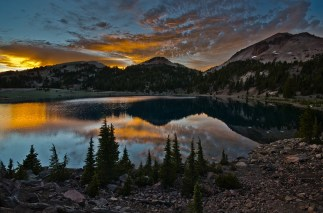 "Lassen Volcanic National Park in California is home to steaming fumaroles, meadows freckled with wildflowers, clear mountain lakes and numerous volcanoes. David Olden captured this breathtaking shot of the park at sunset. Of the experience, he says: ""Some memories in life are etched into our mind, sometimes we're lucky enough to realize that while we are experiencing the moment. This was one of those moments for me. Not a soul in sight as I sat and watched the sky change colors over Helen Lake with Lassen Peak behind it."" Posted on Tumblr by the US Department of the Interior, 5/16/15."