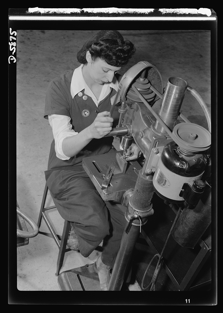 Women in industry. Aircraft motor workers. Youthful Paderewskis, take note! Her finger made superbly flexible by years of piano practice, this young employee of a Midwest aircraft motor plant finds her musical training of great assistance in her war job. The operation of this drill press demands constant, rapid hand and wrist movement--and that's where those hours of do-re-mi are paying dividends. She's countersinking six holes in a bolt, an operation requiring great precision, speed and skill. Office of War Information, August 1942.