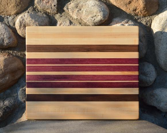 """Cutting Board 15 - 048. Hard Maple, Black Walnut and Purpleheart edge grain. 13"""" x 15"""" x 1-1/4"""". Sold at its first showing."""