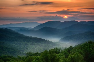 Sunrise at Great Smoky Mountains National Park. As the sun peeks over the clouds, the fog begins to lift off the mountains. Photo by Chris Mobley. Posted on Tumblr by the US Department of the Interior, 6/19/15.