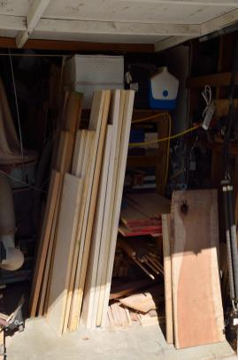 Too much lumber to fit into the rack, so it has to stand up until processing can begin.