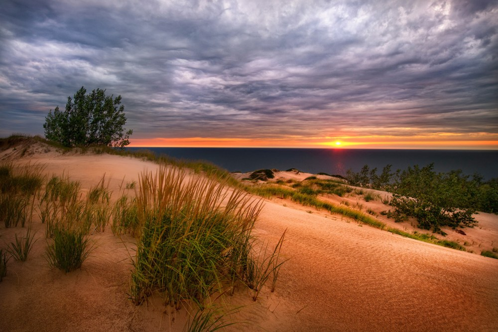 Lake Michigan Overlook In Sleeping Bear Dunes National Lakeshore, near Empire, MI. Picture by Steve Perry. Posted on Tumblr by the US Department of the Interior, 7/6/15.