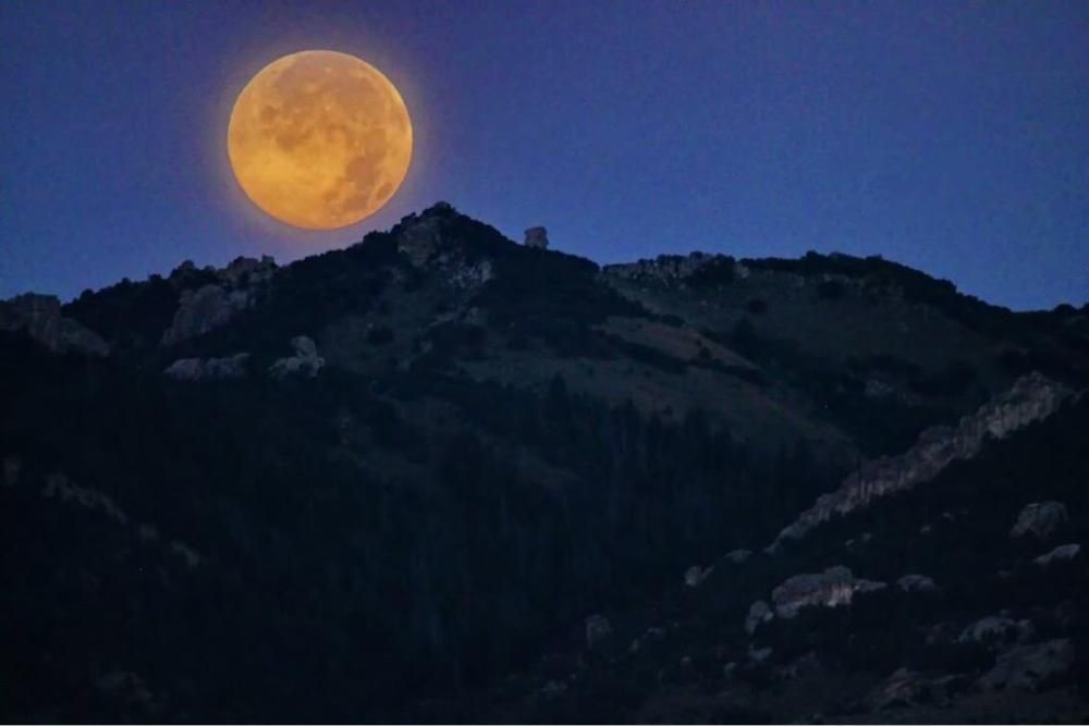"The ""blue moon"" as seen from the City of Rocks National Monument. Tweeted by the US Department of the Interior, 8/1/15."