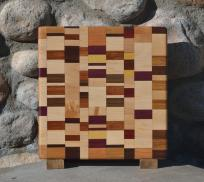 "Small Board # 15 - 049. Hard Maple, Cherry, Padauk, Jatoba, Purpleheart, Yellowheart, Black Walnut & Canarywood. Edge Grain. 11"" x 11-1/4"" x 1""."