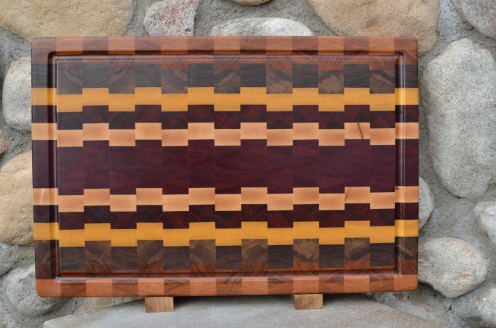 "Cutting Board 15 - 072. Cherry, Black Walnut, Yellowheart, Hard Maple, Padauk & Purpleheart. Edge Grain, Juice Groove. 15"" x 18"" x 1-1/2""."