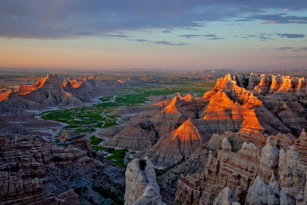 How can they call it Badlands when the views are just so good? Badlands National Park in South Dakota draws visitors from around the world with its rugged beauty and rich fossil beds. It's a place to explore the unique landscape while imagining the ancient mammals that once roamed here. Sunrise is a particularly good time for contemplation and reflection. Photo by Harlan Humphrey. Posted on Tumblr by the US Department of the Interior, 10/8/15.