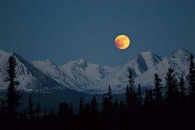 A full moon over the Denali National Park. Photo by Katie Thoresen. Tweeted 10/18/15 by the US Department of the Interior.