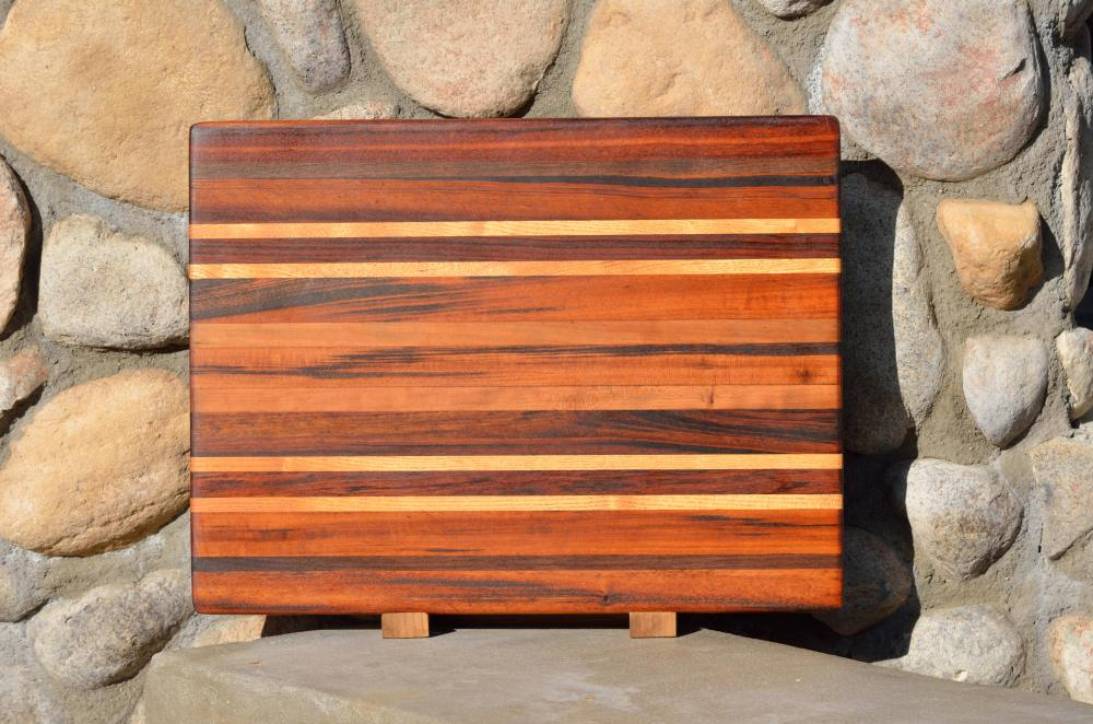 "Velda's Cutting Board. Goncalo Alves (Tigerwood), Black Walnut, Honey Locust, Jatoba & Cherry. Edge grain, and 2 years old as shown. 16"" x 21"" x 1-1/4""."