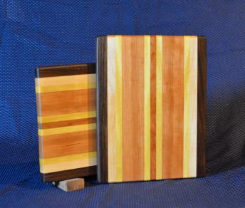 "Cheese Board # 15 - 045. Black Walnut, Hard Maple, Cherry & Yellowheart. Edge Grain. 8"" x 11"" x 3/4""."